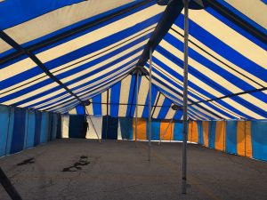 Under the 40' x 70' Galla rope and pole tent setup for a fireworks stand in Davenport, Iowa