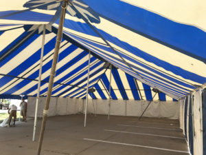 Under the 40' x 70' blue and white rope and pole fireworks tent at Hy-Vee S. 1st Ave in Iowa City for Bellino Fireworks