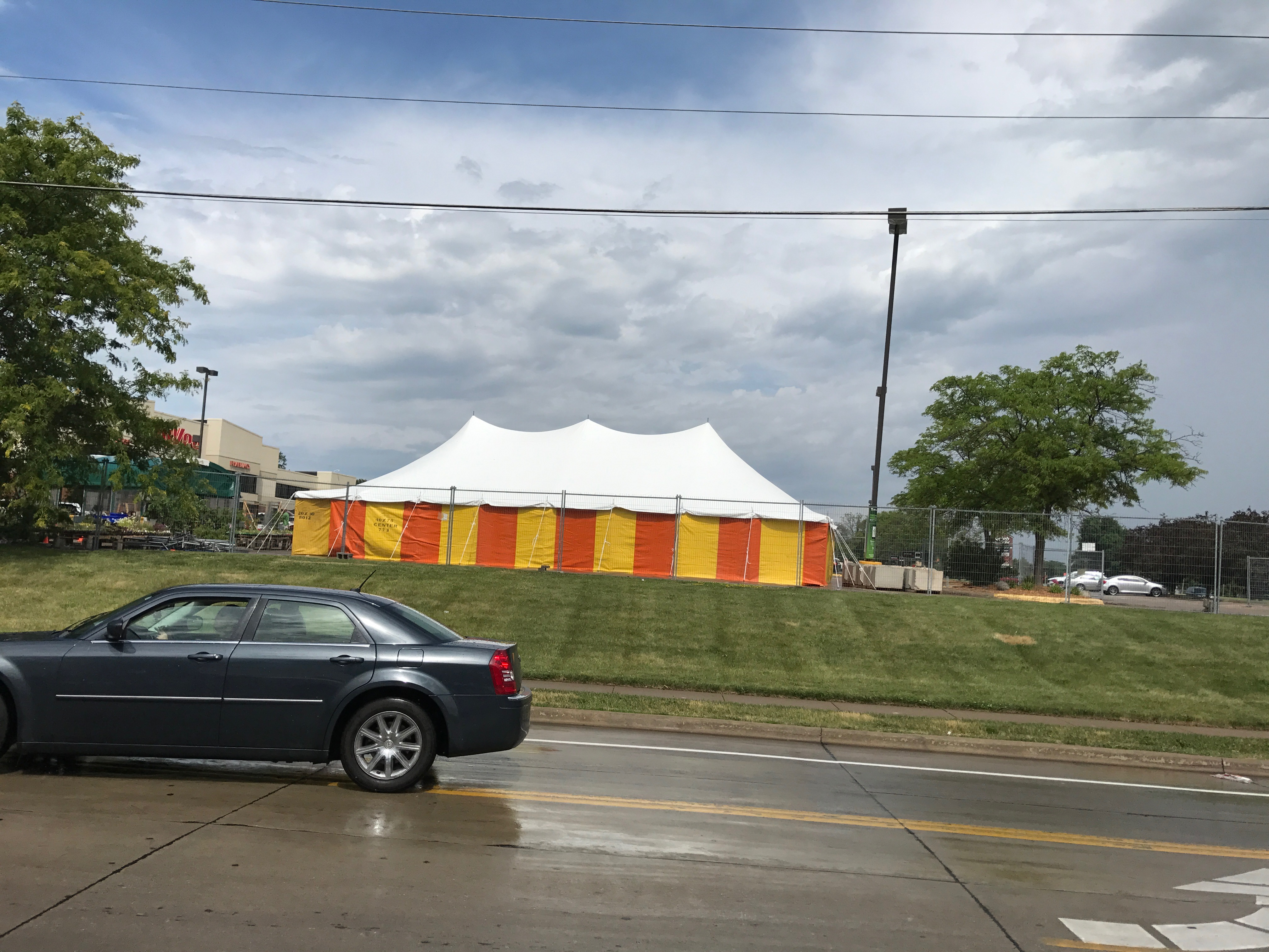 View from the road of our 30' x 60' rope and pole tent at Hy-Vee 1823 E Kimberly Rd in Davenport, Iowa with Yellow and Orange side walls