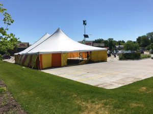 View of the parking lot at HyVee on Dodge St. in Iowa City with 40' x 60' rope and pole tent for Bellino Fireworks