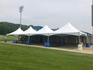 Four 20' x 20' Tentnology frame tents side-by-side at the Muscatine Soccer Field in Iowa