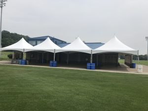 Four 20' x 20' Tentnology frame tents side-by-side in Iowa