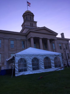 Frame tent set up for the musicians at the Iowa City Jazz Festival 2017 set up at night