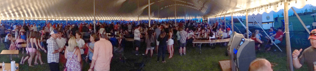 "Lots of people under the 60′ x 150′ ""twin pole"" Legend rope and pole tent at Blues and BBQ in North Libery, Iowa"