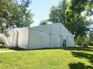 Side of 60' x 66' clearspan Losberger-made tent with two 12-Ton Air conditioning unit outside