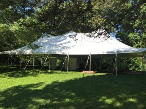 Side view of our 30' x 60' rope and pole wedding tent in Mount Vernon, Iowa