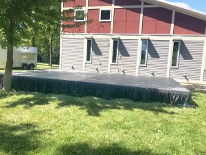 Stage with skirting and our beer trailer in the background see left