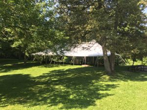 Trees around the 30' x 60' rope and pole wedding tent in Mount Vernon, Iowa