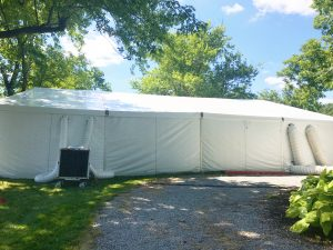 Two 12-Ton Air conditioning unit outside a 60' x 66' clearspan Losberger-made tent in Iowa