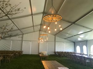 Under a 60' x 66' clearspan Losberger-made tent with lights