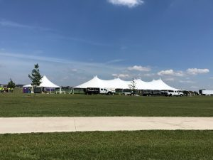View of rope and pole tents at the North Liberty Blues & BBQ festival at Centennial Park in North Liberty, Iowa
