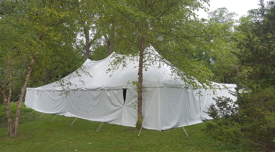 Backyard Wedding Reception Tent Surrounded by Trees with white walls in Monticello, IA header