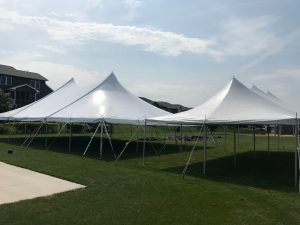 Block party setup with 40' x 60' rope and pole on the left and 20' x 40 rope and pole tent on the right