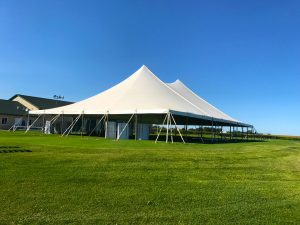 Outside of White 60' x 90' rope and pole tent for a Wedding & Wedding Reception in Newton, IA