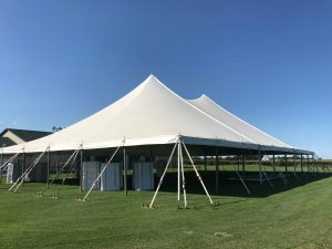 Side of White 60' x 90' rope and pole tent for Outdoor Wedding & Wedding Reception in Newton, Iowa