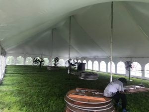 Under a 40' x 80' Rope and Pole wedding tent in Carroll, Iowa