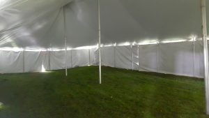Under the 30' x 60' rope and pole wedding tent with white sides Monticello, IA