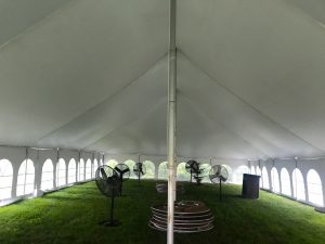 Under the middle of a 40' x 80' Rope and Pole wedding tent in Carroll, Iowa