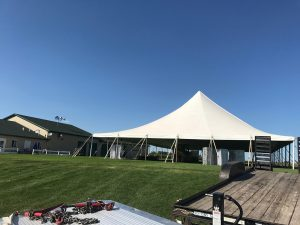 White 60' x 90' rope and pole tent for a wedding in Newton, Iowa
