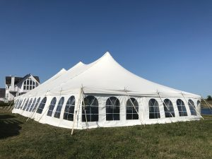 Corner of 40' x 80' rope and pole wedding tent setup in Fairfield, Iowa