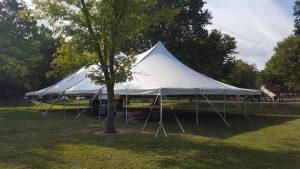 Outside of 40' x 80' rope and pole tent at a campground near Muscatine, Iowa