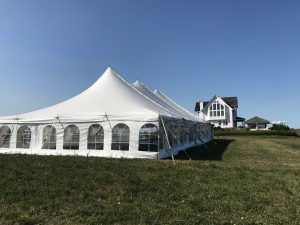 Perspective of 40' x 80' rope and pole wedding tent setup in Fairfield, Iowa