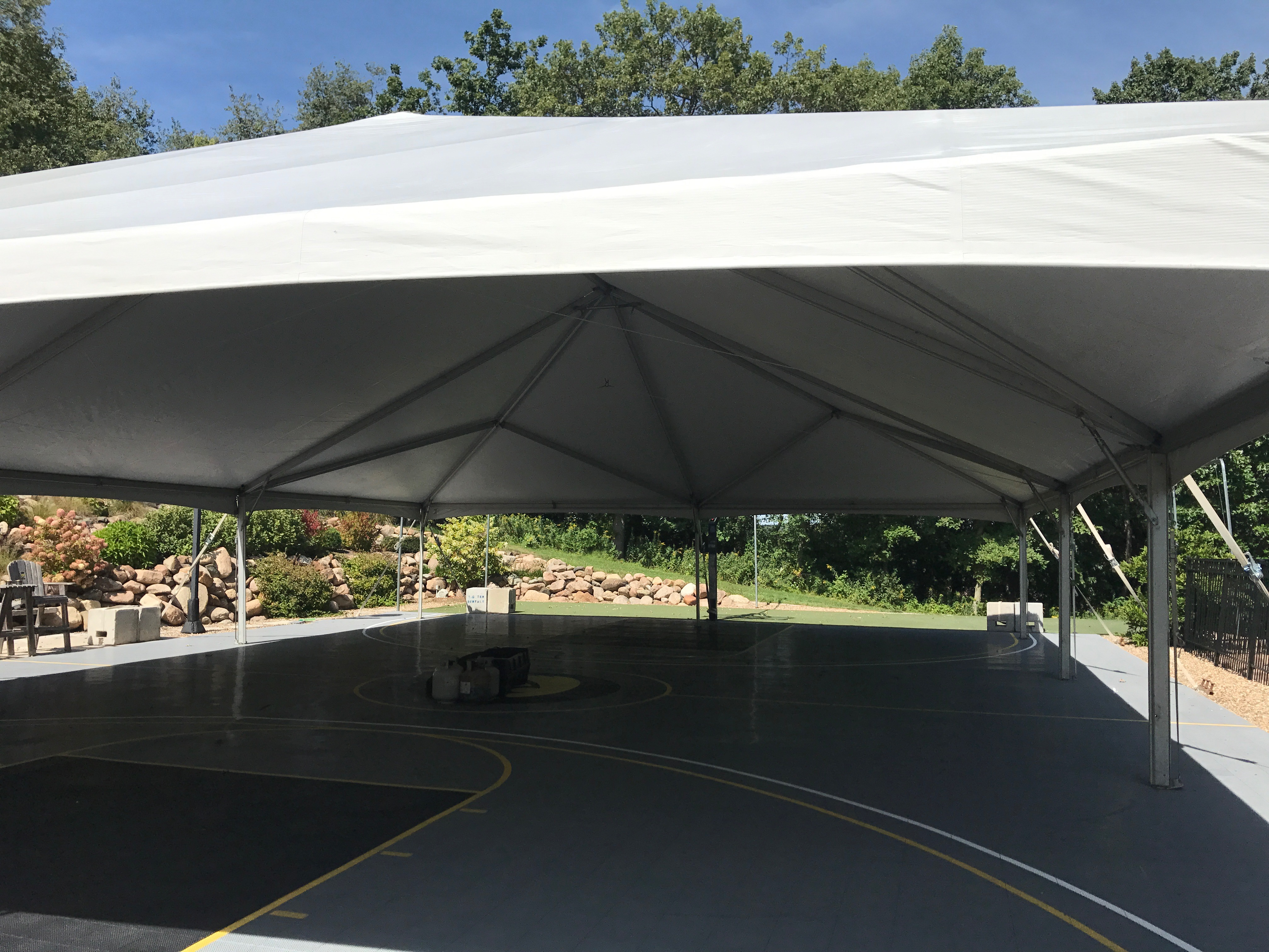 Under the 40' x 60' hybrid event tent setup on a Basketball court in Coralville, IA