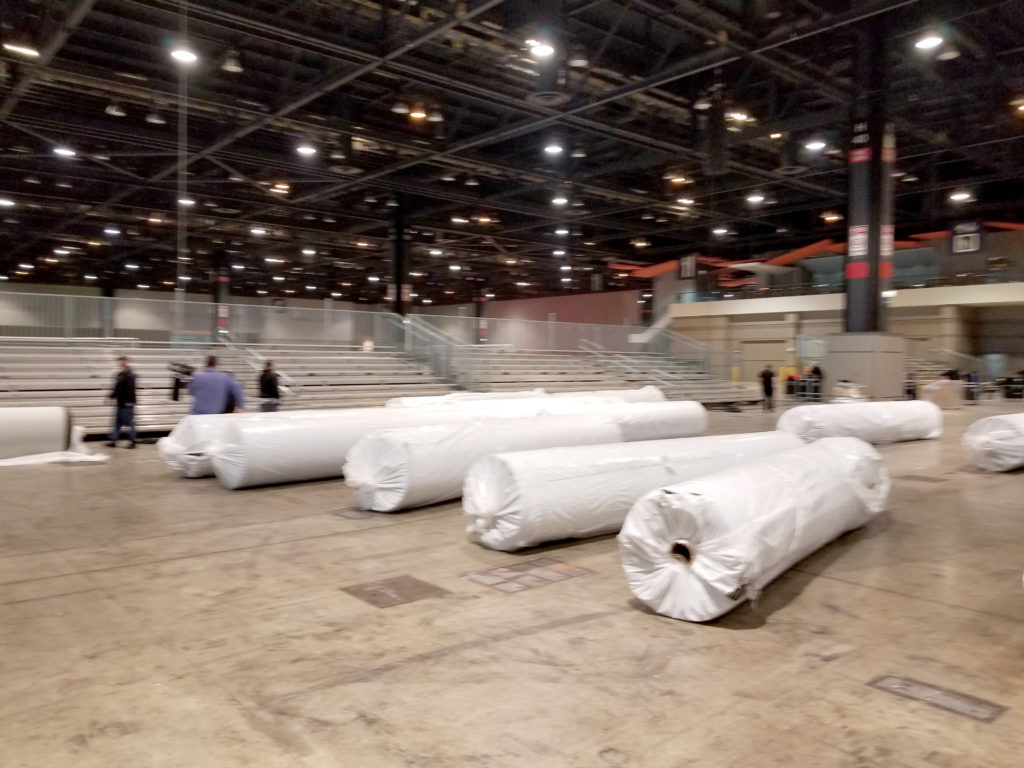 Bleacher delivery in Chicago, Illinois for for United Soccer Coaches in Mccormick Place (blur image)